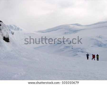 Climbers on Crown prince Olav glacier (Kronprins Olavs Bre) on Jan Mayen island in the Arctic