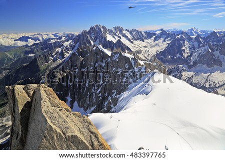 Climbers on French Alps Mountains near Aiguille du Midi on a sunny day in France, Europe