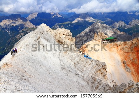 "Climbers on via ferrata ""Ivano Dibona"" heading to the Lorenzi refuge, Dolomite Alps, Italy - stock photo"