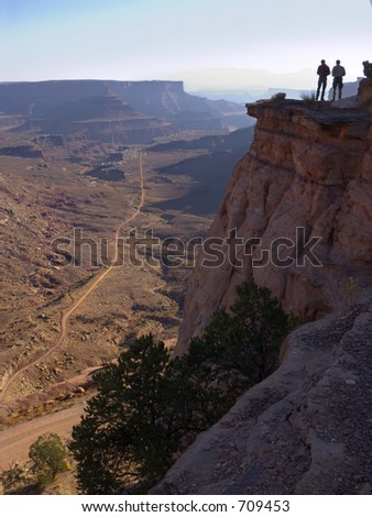 Climbers take time to appreciate the vista at the end of the trail - stock photo