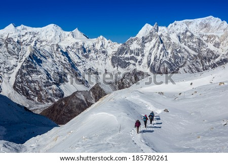 climbers walk up on glacier in the mountain  - stock photo