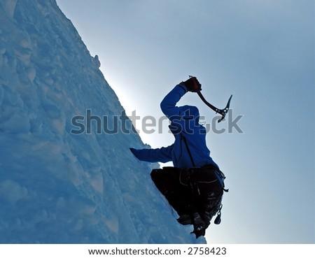 Climbing a frozen wall - stock photo