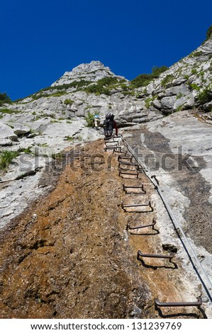Climbing a ladder to the sky - stock photo