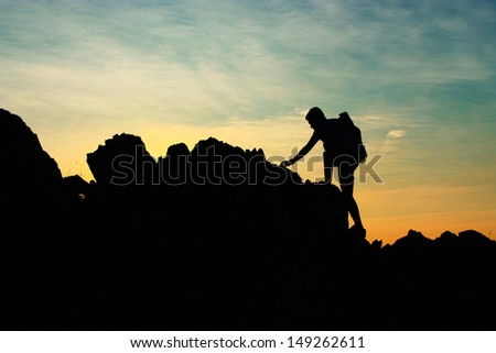Climbing a mountain. - stock photo