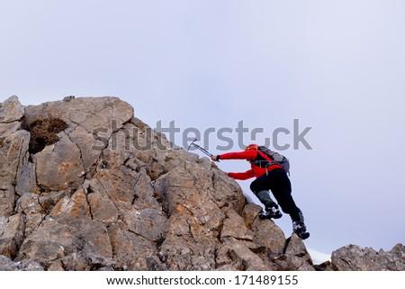 Climbing a mountain - stock photo