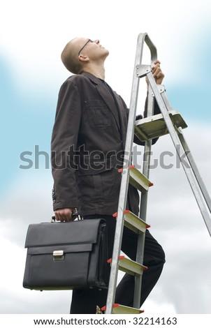 Climbing business men - stock photo