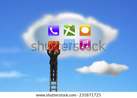climbing businessman getting app icons from cloud with nature blue sky background - stock photo