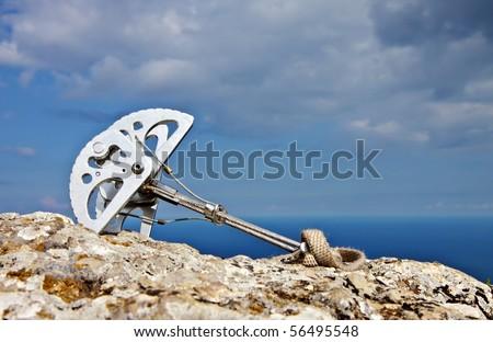 Climbing eqiupment placed on the rock - stock photo