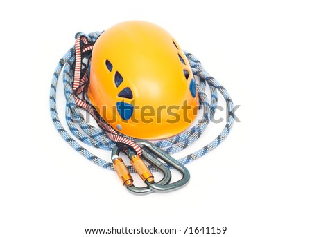 climbing equipment - carabiners, helmet and rope - stock photo