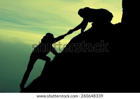 climbing help - stock photo