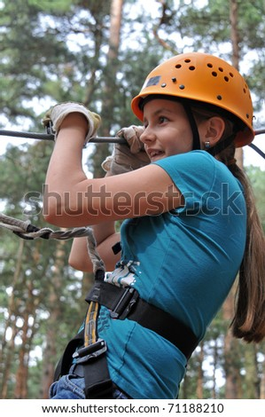 climbing in a forest - stock photo