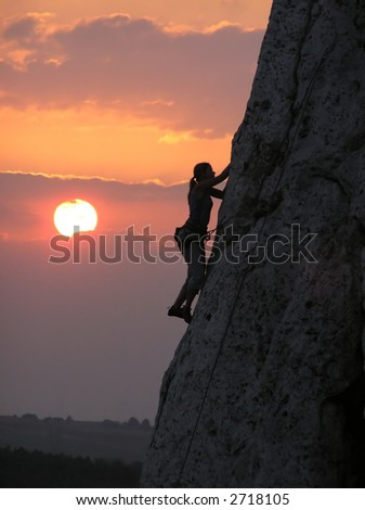 climbing in a sunset