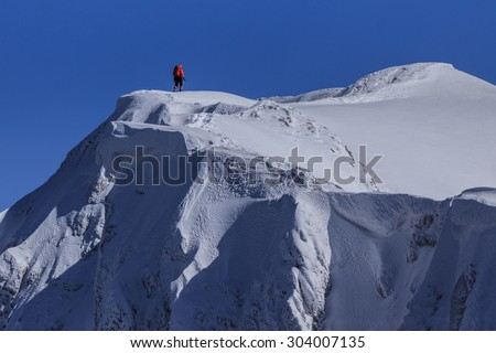 climbing on mountain in winter. Piatra Craiului Mountains, Romania - stock photo