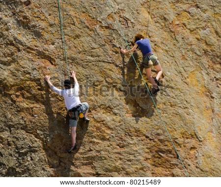 climbing on the rock - stock photo