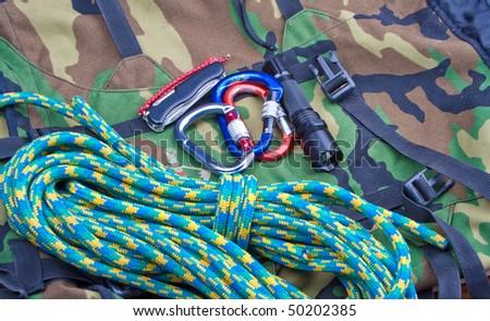 Climbing set on khaki fabric - stock photo