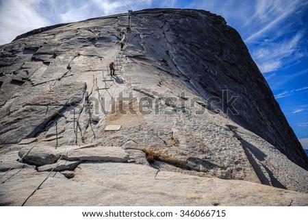 Climbing the Half Dome Cables, Yosemite National Park, California  - stock photo