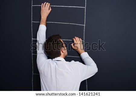 Climbing the ladder of success - stock photo