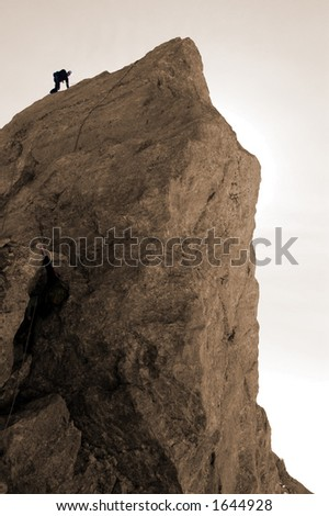 Climbing the last pitch on the Grand Teton Wyoming 13770' - stock photo
