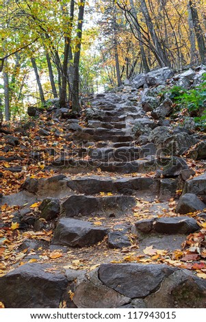 Climbing trail with stone steps in Baraboo, WI - stock photo