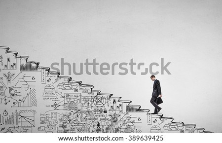 Climbing up the career ladder - stock photo