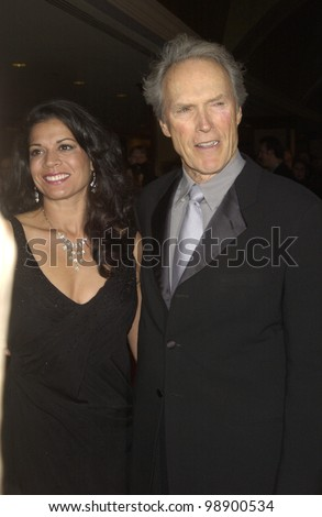 CLINT EASTWOOD & wife DINA RUIZ at the 56th Annual Directors Guild Awards in Century City, Los Angeles, CA.  February 7, 2004