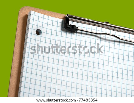 Clip board with grid paper and eco green border - stock photo