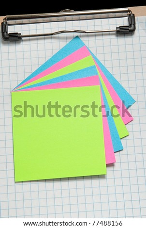 Clip board with grid paper and notes on top - stock photo