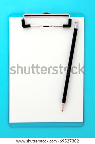Clipboard and pencil on blue background