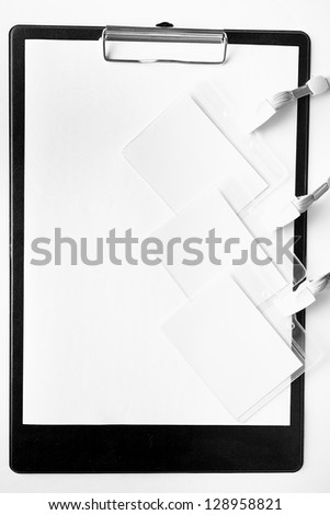 clipboard, pens and badges - stock photo