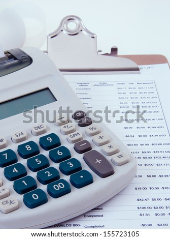 clipboard with budget sheet and calculator - stock photo