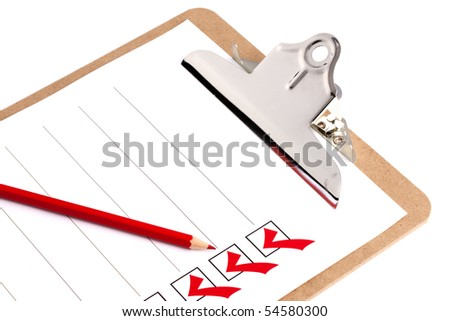 Clipboard With Checklist with a red pencil on a white background - stock photo