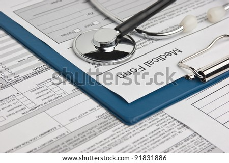 clipboard with medical form and phonendoscope - stock photo