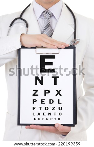 clipboars with eye test chart in doctor's hands - stock photo