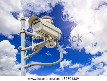 cliping path of safety vdo and camera with nice sky background - stock photo