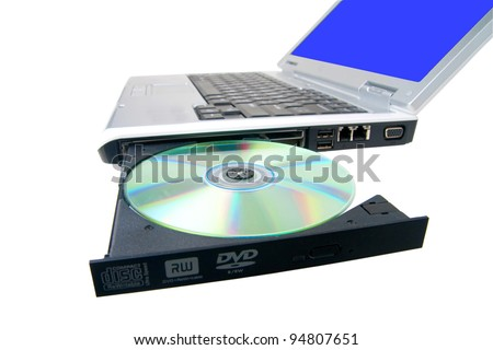 Clipping path. DVD on laptop. Notebook with CD-ROM. Laptop Disc Tray. Isolated on a white background. Clipping path. - stock photo