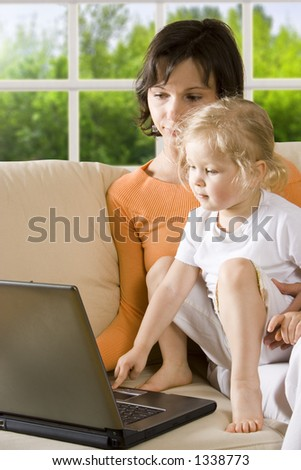 CLIPPING PATH! Mother with daughter on the sofa - stock photo