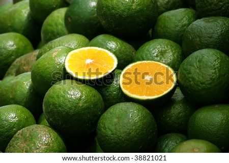 Clipping path of oranges is on a crowd of oranges - stock photo