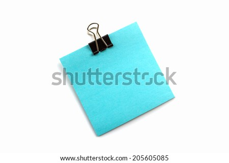 Clips and blue note on white background.