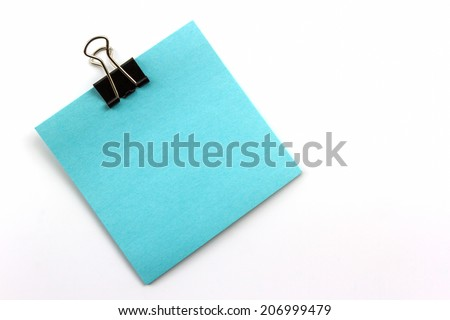 Clips and blue note on white background.  - stock photo