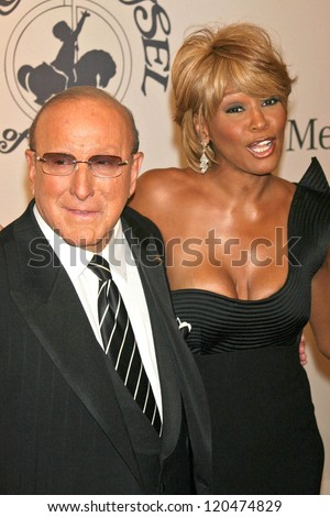 Clive Davis and Whitney Houston at the 17th Carousel of Hope Ball to benefit The Barbara Davis Center for Childhood Diabetes. Beverly Hilton Hotel, Beverly Hills, CA. 10-28-06 - stock photo