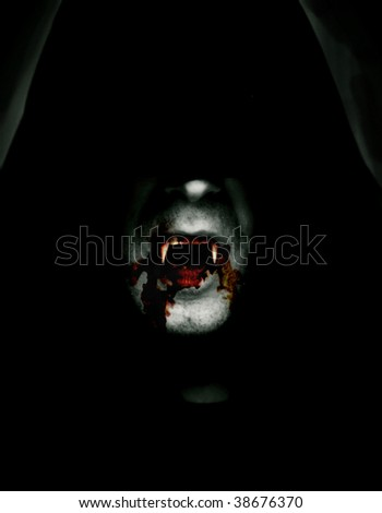 cloaked vampire - stock photo