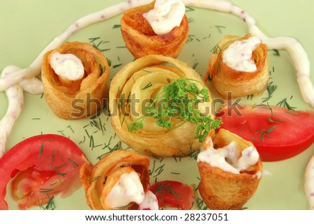 cloce up of fried potato's with vegetables - stock photo
