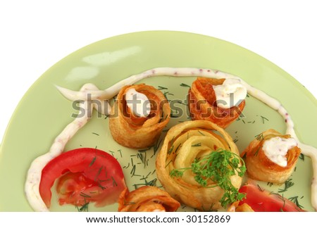 cloce up of fried potatoes with vegetables - stock photo