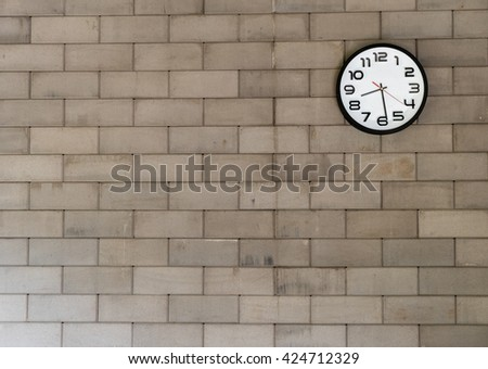 Clock analog brick wall background. - stock photo