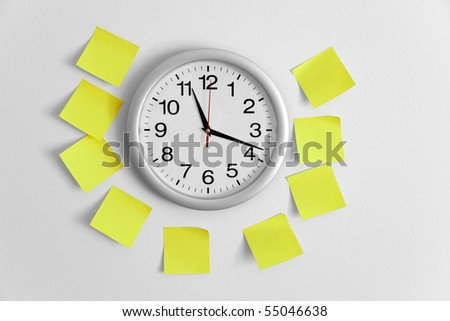 Clock and Adhesive Note close up - stock photo