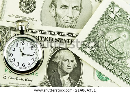 Clock and cash. Time is money - stock photo