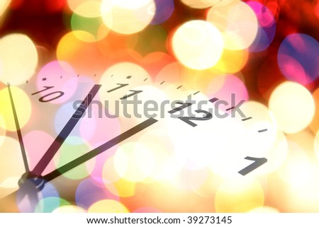 Clock and colorful lights. Symbolic. Christmas. New Year. - stock photo