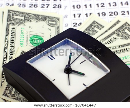 clock and dollars - stock photo