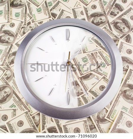 Clock and 100 dollars banknotes on a white background - stock photo