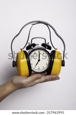 Clock and headphones on one hand, your time in your arms